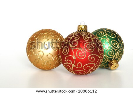 three beautiful christmas ornaments on white background with copy space