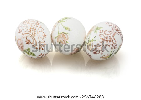 Three beautiful Easter eggs with reflection on the white background. #256746283