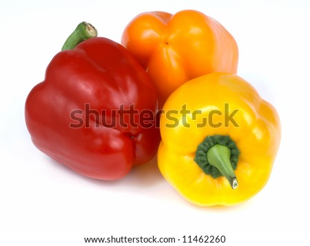 Three beautiful, fresh, colorful and healthy peppers isolated