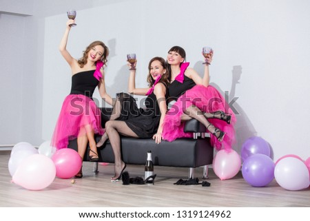 Three beautiful fun trendy women with beautiful makeup smile, laugh and celebrate with balloons #1319124962