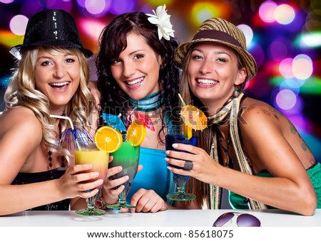 three beautiful girls celebrating in a club