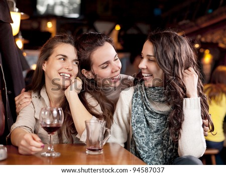 Three beautiful girls in a bar
