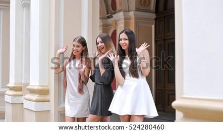 three beautiful girls on a walk ...