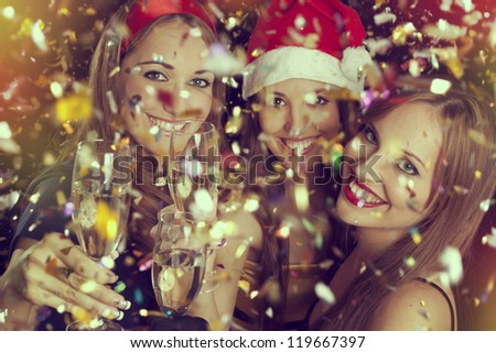 Three beautiful girls on the New Year's Eve #119667397
