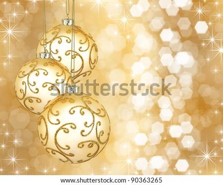 Three beautiful golden christmas balls on a golden background