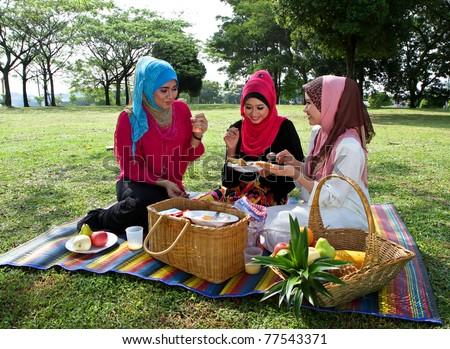 Three beautiful Muslim girls at the park