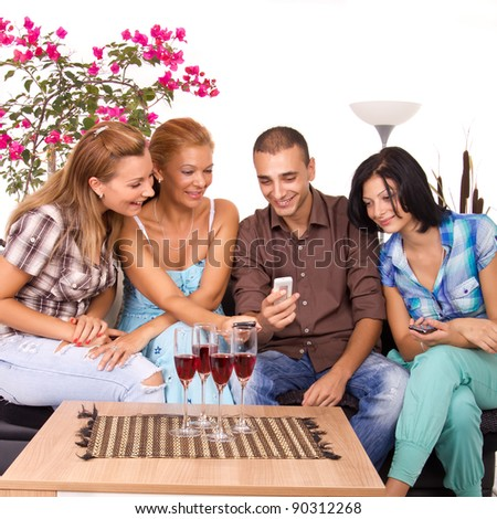 Three Beautiful Women and man Friends Using Smart Phone