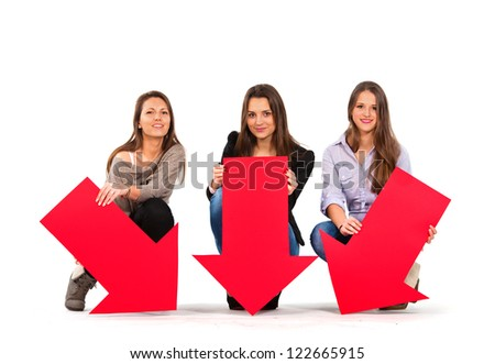 Three beautiful women holding arrows pointing down