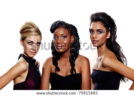 Three beautiful women of different races with different makeup and fashion hairstyles over white background. Focus on the blond