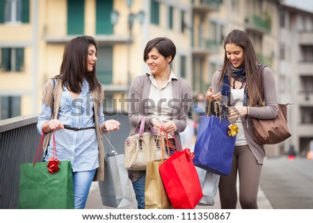 Three Beautiful Young Women with Shopping Bags