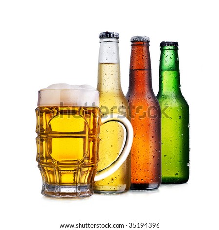 Three beer bottles of different colors and a chop full of beer with froth over a white background - stock photo