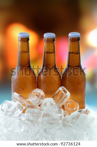 Three beer bottles on ice
