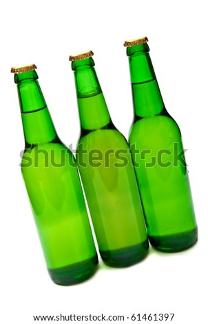 Three beer bottles on white background.