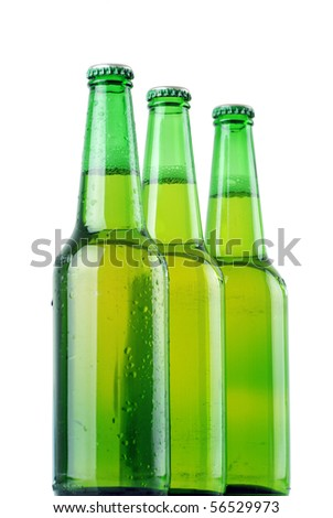 Three beer bottles with water drops on white