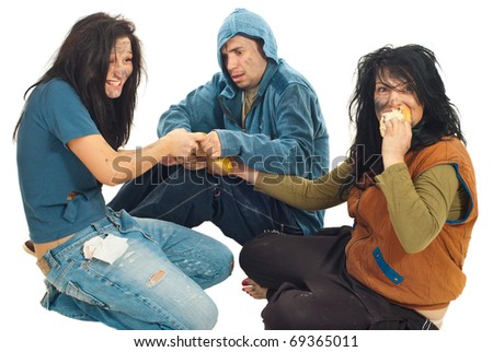 Three beggars sharing a bread and  eating isolated on white background
