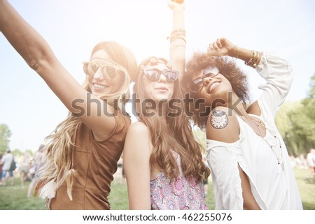 Shutterstock Three best friends at the music festival