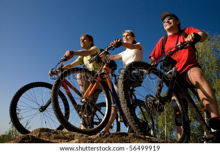 Three  bicycles on the brink of a rock and look afar from rock breakage - stock photo
