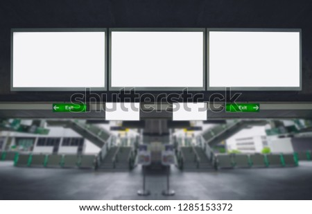three big blank billboard advertising white LED screen horizontal poster hang over on metro station sky train for design text template promotion new brand display advertisement indoor ads mock up. #1285153372