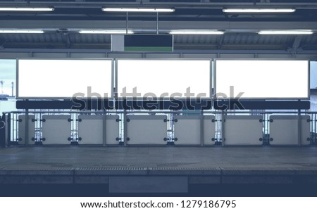 three big blank billboard advertising white LED screen horizontal poster on metro station sky train for design text template promotion new brand display advertisement indoor and outdoor ads mock up. #1279186795