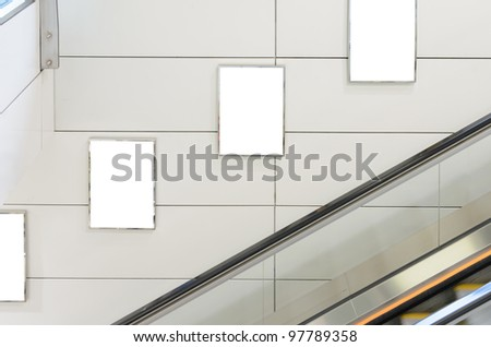 Three big vertical / portrait orientation blank billboard with escalator background