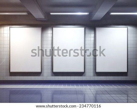 three big vertical poster on metro station