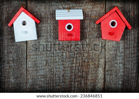 three birdhouses painted with...
