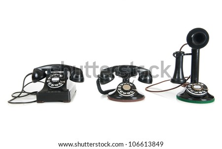 Three black antique phones on a white background