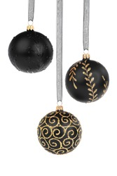 Three black Christmas baubles hanging isolated on white background