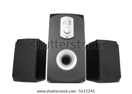 three black computer speakers with built in amplifier isolated on white