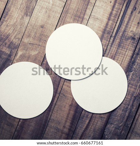 three blank beer coasters on...