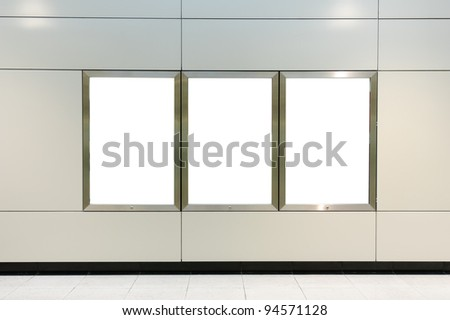 Three blank billboard on modern white wall