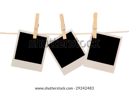 Three blank instant photos hanging on the clothesline - stock photo