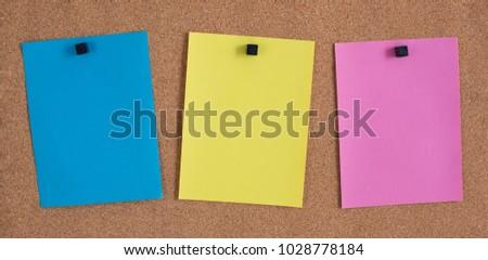 Three Blank Notes on a Bulletin Board