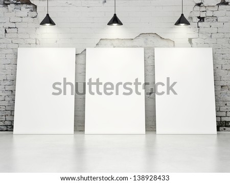three blank posters on old brick wall