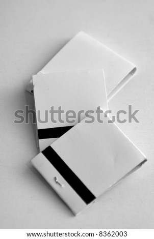 three blank white match books on white background, ready to ad your text