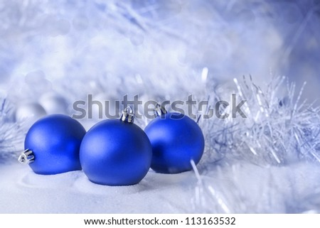 three blue ball lying in the snow