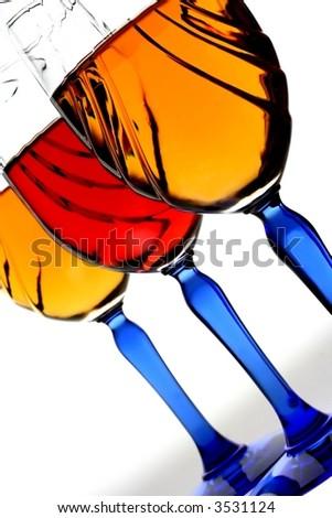 Three blue stemmed decorative wine glasses on white background.