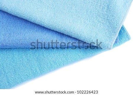 Three blue  towels isolated on white background.