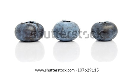 Three blueberries with reflection isolated on white background - stock photo