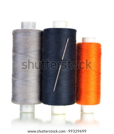 three bobbin thread with needle and sewing pin isolated on white