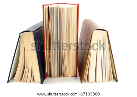 Three books stands a back up on a white background