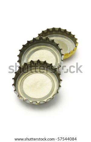 Three bottle caps lying on white background