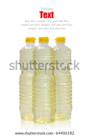 Three Bottle of vegetable oil (Soybean) on a white background.