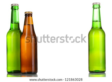three bottles of beer isolated on white - stock photo