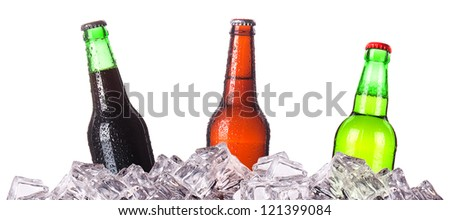 three bottles of beer on ice. Isolated on white background.