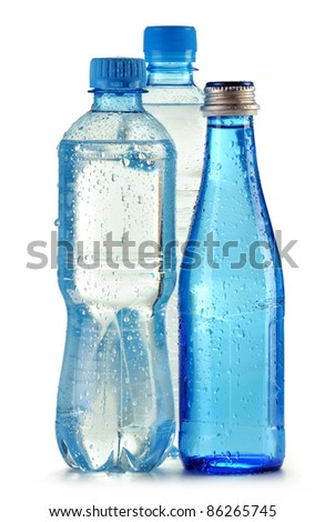 Three bottles of mineral water isolated on white background - stock photo