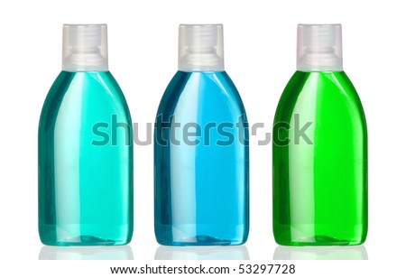 Three bottles of mouthwash with reflection on white background