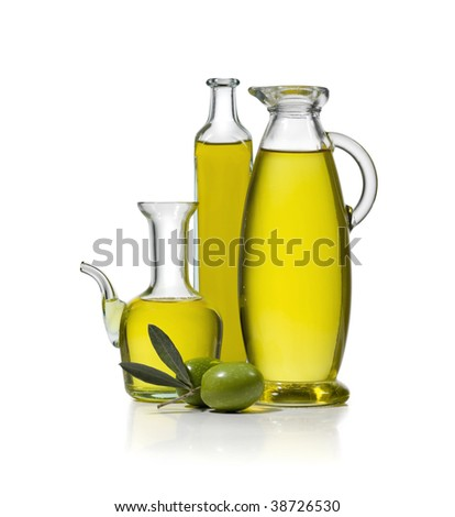 Three bottles of olive oil with two olives on white background