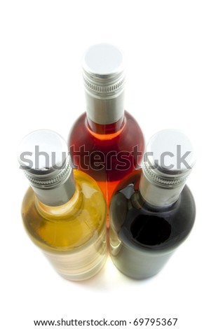 Three bottles of wine isolated over white