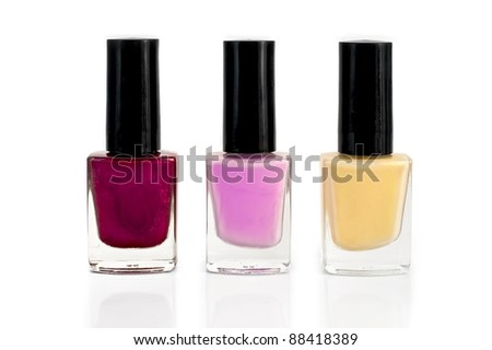 Three bottles with yellow, purple and pink nail polish isolated on white background